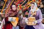 Масленица. Девушки в праздничной одежде играют на балалайке, фото № 5557498, снято 11 февраля 2015 г. (c) Елена Ермакова / Фотобанк Лори