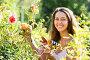 Female florist in summer garden, фото № 6303786, снято 5 августа 2014 г. (c) Яков Филимонов / Фотобанк Лори