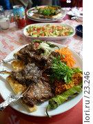 Купить «Тарелка с жареным мясом и тарелка с салатом на столе», фото № 23246, снято 17 ноября 2006 г. (c) Валерий Шанин / Фотобанк Лори