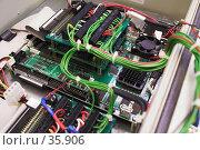 Купить «Внутреннее устройство промышленного компьютера», фото № 35906, снято 6 апреля 2007 г. (c) Роман Коротаев / Фотобанк Лори