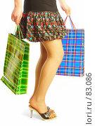 Купить «Девушка с пакетами», фото № 83086, снято 14 мая 2007 г. (c) Андрей Армягов / Фотобанк Лори