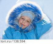 Купить «Девочка лежит на снегу», фото № 138594, снято 19 февраля 2006 г. (c) Serg Zastavkin / Фотобанк Лори