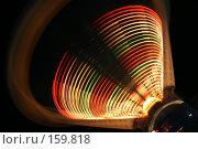 Купить «Праздничная ночная иллюминация на качели в парке аттракционов. Следы разноцветных ламп на движущейся гондоле», фото № 159818, снято 11 июня 2005 г. (c) Harry / Фотобанк Лори