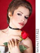 Купить «Красивая девушка с розой на красном фоне», фото № 177822, снято 2 декабря 2007 г. (c) Ирина Мойсеева / Фотобанк Лори