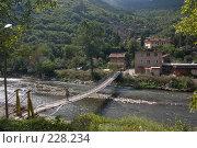 Купить «Мост через небольшую речку в горной долине», фото № 228234, снято 19 августа 2007 г. (c) Harry / Фотобанк Лори