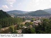 Купить «Небольшой балканский городок, притаившийся в горном распадке», фото № 228238, снято 19 августа 2007 г. (c) Harry / Фотобанк Лори