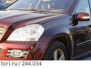 Купить «Фрагмент красного шикарного автомобиля», фото № 244034, снято 29 марта 2008 г. (c) Tatiana Lykova / Фотобанк Лори