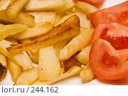 Купить «Жареная картошка со свежими помидорами», фото № 244162, снято 15 февраля 2004 г. (c) Кравецкий Геннадий / Фотобанк Лори