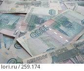 Купить «Российские тысячерублевые банкноты», фото № 259174, снято 17 февраля 2008 г. (c) Лукиянова Наталья / Фотобанк Лори