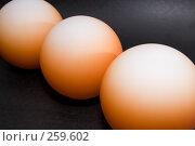 Купить «Оранжевые шары на черном фоне», фото № 259602, снято 22 апреля 2008 г. (c) Андрей Андреев / Фотобанк Лори