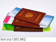 Купить «Три паспорта с вложенными авиабилетами», фото № 261962, снято 24 апреля 2008 г. (c) Наталья Чуб / Фотобанк Лори