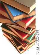 Купить «Стопка из нескольких книг лежит на белом фоне», фото № 323698, снято 17 января 2008 г. (c) Останина Екатерина / Фотобанк Лори