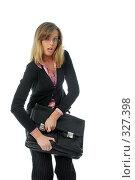 Девушка закрывает портфель. Стоковое фото, фотограф Алексей Попрыгин / Фотобанк Лори