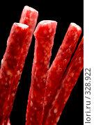 Купить «Копченые маленькие колбаски крупно на черном фоне», фото № 328922, снято 19 июня 2008 г. (c) Угоренков Александр / Фотобанк Лори