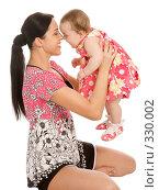 Купить «Молодая мама со своим ребенком», фото № 330002, снято 9 мая 2008 г. (c) Вадим Пономаренко / Фотобанк Лори