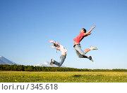 Купить «Девушка и юноша прыгают в поле», фото № 345618, снято 13 июня 2008 г. (c) Ирина Игумнова / Фотобанк Лори