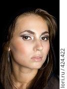 Купить «Портрет красивой девушки на черном фоне изолированно», фото № 424422, снято 26 июня 2008 г. (c) Сергей Сухоруков / Фотобанк Лори