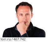 Купить «Задумавшийся молодой человек», фото № 467742, снято 9 декабря 2019 г. (c) Losevsky Pavel / Фотобанк Лори