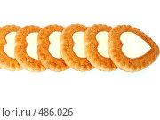 Купить «Печенье в виде сердец на белом фоне», фото № 486026, снято 29 сентября 2008 г. (c) Мирослава Безман / Фотобанк Лори