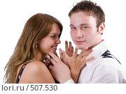 Купить «Молодая красивая пара. Изолировано на белом фоне.», фото № 507530, снято 17 июля 2008 г. (c) Сергей Сухоруков / Фотобанк Лори