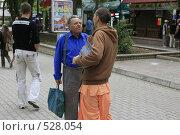 Купить «Евпатория. Кришнаит пропагандирует свою веру на улицах города.», эксклюзивное фото № 528054, снято 13 сентября 2008 г. (c) Дмитрий Неумоин / Фотобанк Лори