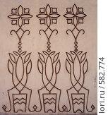 Купить «Три цветка - узор на стене здания», фото № 582774, снято 7 января 2007 г. (c) Чертопруд Сергей / Фотобанк Лори