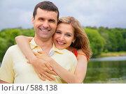 Купить «Молодая женщина обнимает мужчину», фото № 588138, снято 14 ноября 2019 г. (c) Losevsky Pavel / Фотобанк Лори