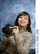 Купить «Портрет с фотоаппаратом», фото № 666698, снято 10 января 2009 г. (c) Дмитрий Тарасов / Фотобанк Лори