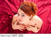 Купить «Молодая красивая женщина в красном платье. Вид сверху», фото № 687306, снято 7 декабря 2008 г. (c) Beerkoff / Фотобанк Лори