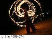 Купить «Девушка исполняет огненнный танец (fireshow) ночью на пляже», фото № 689674, снято 4 сентября 2008 г. (c) Алексей Корсаков / Фотобанк Лори