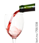 Купить «Красное вино, наливаемое из бутылки в бокал, на белом фоне», фото № 700538, снято 28 декабря 2008 г. (c) Мельников Дмитрий / Фотобанк Лори
