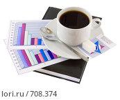 Купить «Закрытый ежедневник,чашка кофе и экономические  цветные графики», фото № 708374, снято 11 января 2009 г. (c) Vitas / Фотобанк Лори