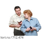 Купить «Пожилая семейная пара с пенсионными удостоверениями», фото № 712474, снято 14 февраля 2009 г. (c) Vitas / Фотобанк Лори