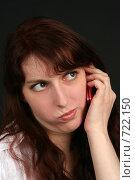 Купить «Девушка разговаривает по телефону с недовольным выражением лица», фото № 722150, снято 7 февраля 2009 г. (c) Наталья Белотелова / Фотобанк Лори