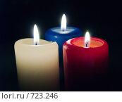Купить «Три горящих свечи на черном фоне», фото № 723246, снято 25 февраля 2009 г. (c) Кирпинев Валерий / Фотобанк Лори