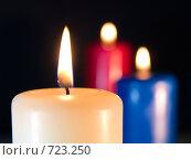 Купить «Три горящих свечи на черном фоне», фото № 723250, снято 25 февраля 2009 г. (c) Кирпинев Валерий / Фотобанк Лори