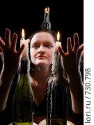 Купить «Девушка и горящие свечи», фото № 730798, снято 22 февраля 2009 г. (c) hunta / Фотобанк Лори