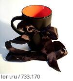 Купить «Кружка с бантом», фото № 733170, снято 12 февраля 2009 г. (c) Анастасия Архипова / Фотобанк Лори