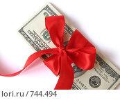 Купить «Стопка 100 - долларовых купюр, перевязанные красной подарочной лентой», фото № 744494, снято 8 ноября 2007 г. (c) Лилия / Фотобанк Лори