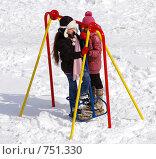 Купить «Две девочки на качелях зимой», фото № 751330, снято 15 марта 2009 г. (c) RedTC / Фотобанк Лори