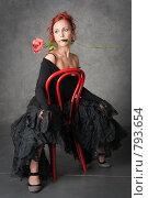 Купить «Очаровательная девушка с красной розой», фото № 793654, снято 27 марта 2009 г. (c) Оксана Гильман / Фотобанк Лори