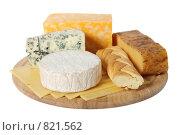 Купить «Разные виды сыра на деревянной дощечке, изолированные на белом фоне», фото № 821562, снято 9 ноября 2008 г. (c) Георгий Марков / Фотобанк Лори