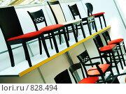 Купить «Стеллаж со стульями на выставке», фото № 828494, снято 25 июня 2006 г. (c) Юлия Сайганова / Фотобанк Лори