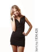 Купить «Девушка с мобильником в черном платье», фото № 834426, снято 5 апреля 2009 г. (c) Евгений Батраков / Фотобанк Лори