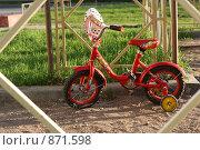 Купить «Детский велосипед на площадке», фото № 871598, снято 18 мая 2009 г. (c) Ольга Рындина / Фотобанк Лори
