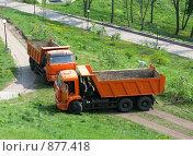 Купить «Грузовики», фото № 877418, снято 2 мая 2009 г. (c) Юлия Подгорная / Фотобанк Лори