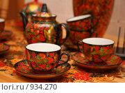 Купить «Чайный сервиз в стиле хохлома», эксклюзивное фото № 934270, снято 20 июня 2009 г. (c) Gagara / Фотобанк Лори