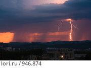Молния во время заката. Стоковое фото, фотограф Евгений Булатов / Фотобанк Лори