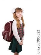 Купить «Школьница с портфелем. Ученица в школьной форме с ранцем на белом фоне», фото № 995322, снято 28 марта 2009 г. (c) Ирина Карлова / Фотобанк Лори