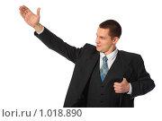 Купить «Молодой бизнесмен с поднятой рукой», фото № 1018890, снято 12 февраля 2009 г. (c) Losevsky Pavel / Фотобанк Лори
